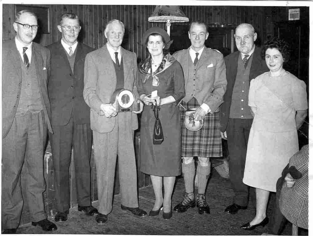 Col Pat Grant presentation on his leaving Knockie Estate  c1966. William Mackintosh ( Newlands), Alister Chisholm (Gorthleck), Col & Mrs Pat Grant (Knockie), Murdo Campbell (Torness), Ewen Macdonald  (Aberhaulder), Isobell Fraser (Faraline).   Photograph courtesy of Alister Chisholm