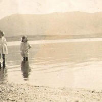 Maisie & Ella Macmillian  paddling in Lochmhor in the mid thirties