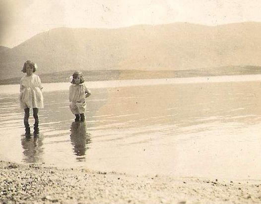 Maisie & Ella Macmillian  paddling in Lochmhor in the mid thirties