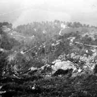 Corkscrew and Inverfarigaig from the summit of Dun Deardial  c1935 .  Though picture quality is not great  it  clearly demonstrates how the road got its local bye-name , today the sides of the road is covered with trees and shrubbery so the corkscrew view of the thirties is no more . Photograph courtesy of Roger Creegan