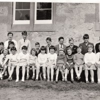 Errogie School 1967 Back:- Mrs Margaret Thirde (Teacher) , Sandy Matheson (Ruthven) . Middle :- Alister Fraser, Angus Matheson(Ruthven),Willie Fraser(Migovie) , John Junor(Ballaggan) , Peter Junor(Ballaggan), Kenneth Fraser(Migovie) , Johnnie Fraser(Balnabeeran), John Fraser(Migovie). Front:- Kathleen Fraser(Balnabeeran) , Ruth MacGillveray(Lyne), Ann Matheson(Ruthven), Isobel Matheson(Ruthven), Julia Thirde, Catherine Fraser, Jane Matheson(Ruthven), Carol Mackenzie, Maureen Macpherson (Abersky) , Isobel Macpherson (Abersky) , Ann Fraser, Fiona Macgillivray (Lyne)