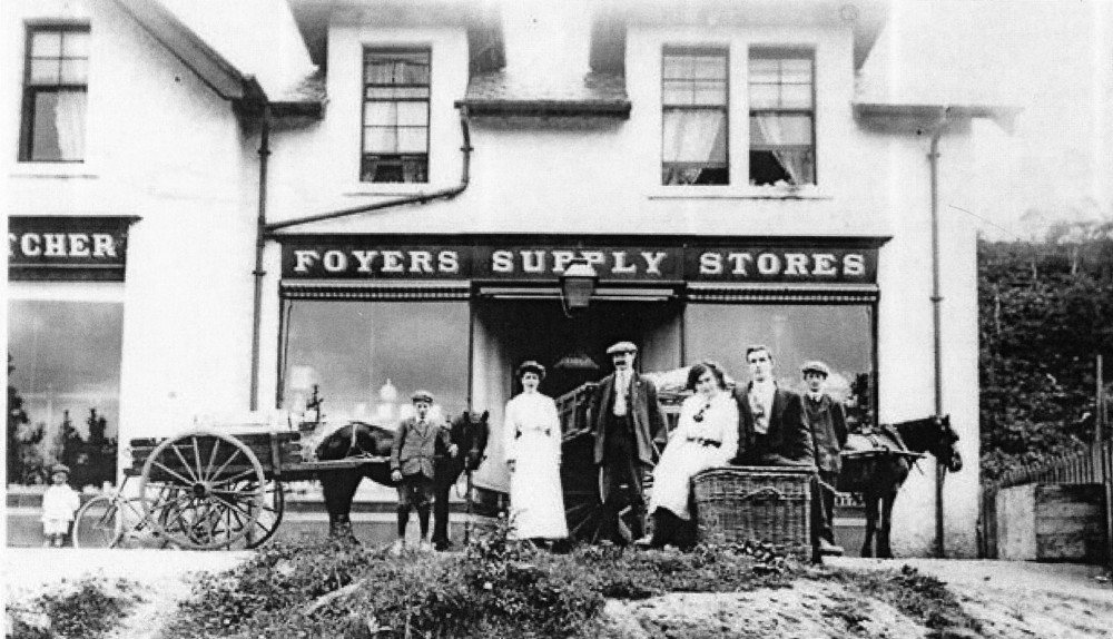 Foyers  Shop around 1910 with donkey and pony cars that were used to transport supplies from steamer to shop and  distribute them round village . People in picture L-R  Unknown , Unknown , Kate Ramsay , John Ramsay owner, on basket  Winnie Ramsay, David Ramsay , unknown . Photograph and names courtesy of Kitty Fraser Gorthleck .