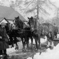 Laracks Snowplough, Lyne of Gorthleck  c1928  A horsedrawn snow plough  with local road contractor Ewen Fraser at the rear and Mr Macintosh the Baker at the front    Photograph courtesy of Nan Fraser.