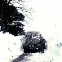 Macbrayne's Whitebridge Bus c 1946 , possibly taken at Lyne of Gorthleck , beside a large snow drift  which in all probability had to be opened by hand to clear the road as the local snow plough would be too small to break through the drift.