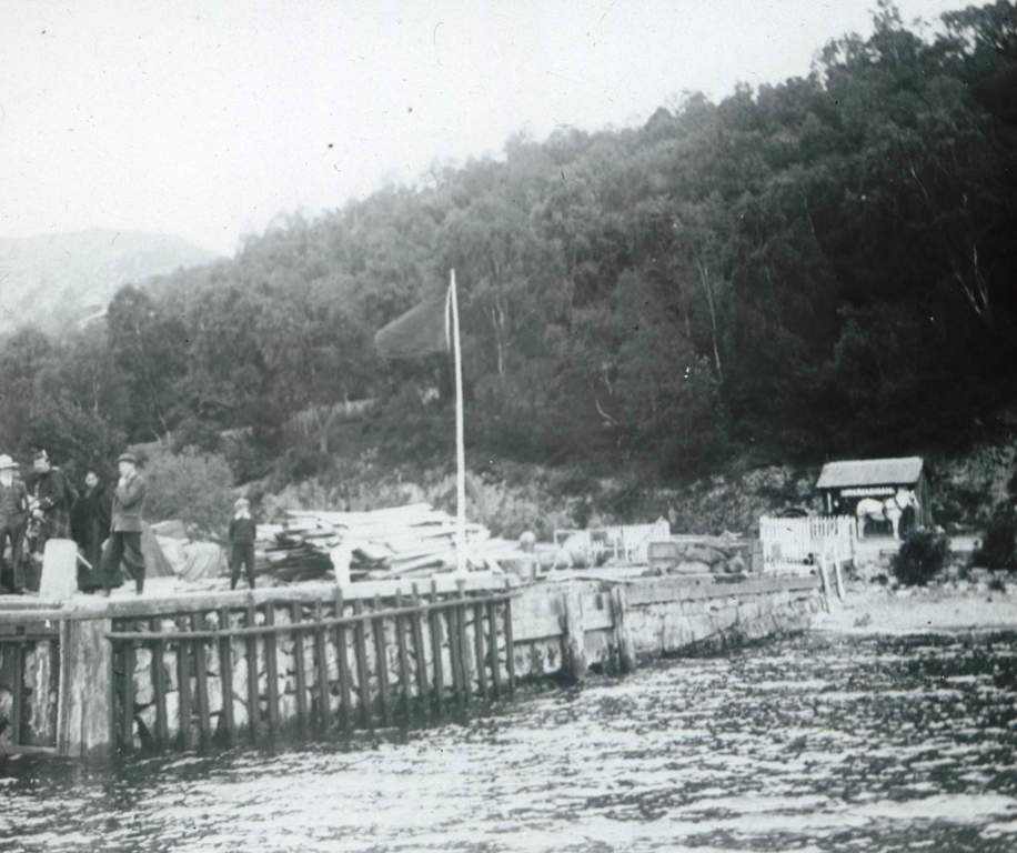 Inverfarigaig Pier taken around 1903 , People on pier awaiting approaching steamer including gentleman in full Highland dress    Photograph courtesy of Alister Chisholm