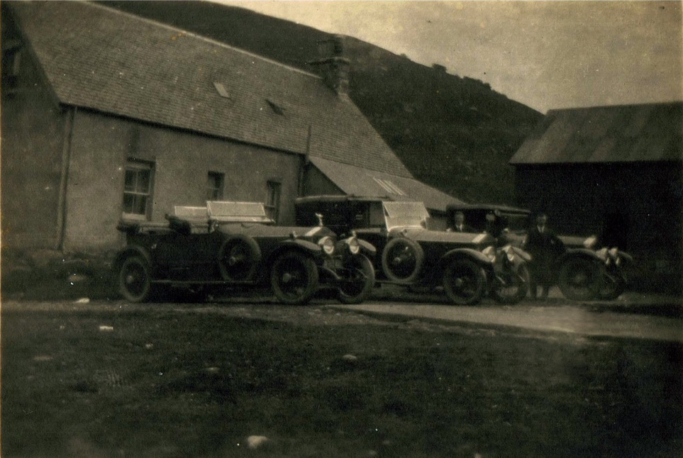 Stronelarig Keepers house as it was in 1922.  The  photo shows the contributors grandfather  who was the chauffeur to Lord  Dalmeny along side  the transport they used to convey them to Stronelarig for the grouse shooting in August 1922 .  The head keeper  on the estate at this time was Archie Macfarlane a renowned character in the area  . Photograph courtesy of Val Fittall