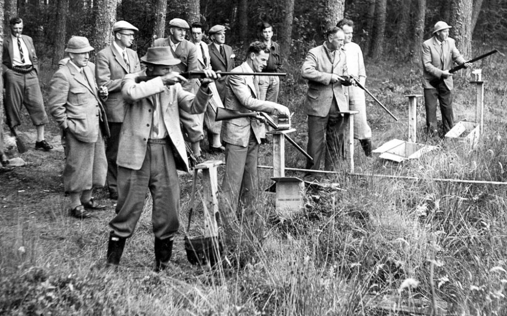 Stratherrick Gun Club  shoot at Lyne of Gorthleck  in 1959. the shoot was held on the edge of the wood at the rear  of Laracks cottage .   Back:-  Bob Hendry (Strathconnon),  Donald Robertson, ? , Willie Macintosh(Newlands), Rod Macgreggor(Kindrumond), Eddie Fraser(Knockcarroch), Ewen Fraser(Migovie), Eddy  Smith (Foyers). Front:- Tommy Girvan ,  Kenny Macpherson (Killiechoilum), George Girvan ,  Duncan Macdonell  , Donald (Maka) Macpherson.  Photograph courtesy of William Macintosh