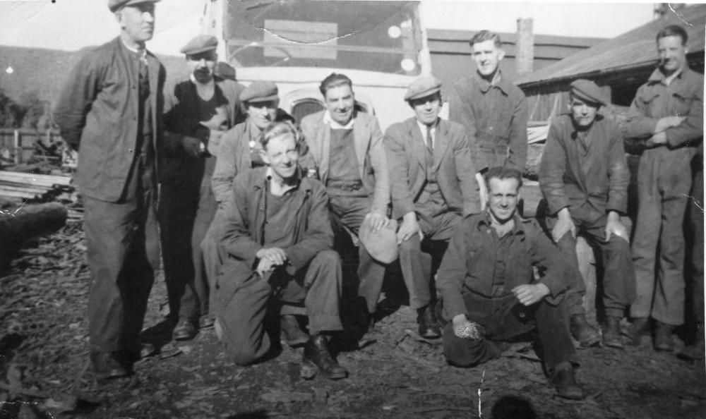 BA Factory Sawmill Group 1947 Back L-R Simon Macintosh, Will Shaw.  Middle L-R Duncan Cameron, Jock Kennedy, Dan Chisholm, Angie Macgruer, Bill Ramsay, Jock Fraser (Fishal). Front L-R Simon Junior, Calum Macdonald . Photograph courtesy of Ala Macgruer