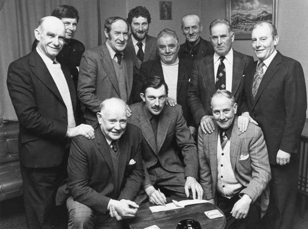 """Braxie Ball Committee c1977 The Braxie Ball was an annual ticked event held around October in Stratherrick Hall , its function was to raise funds  for things like the OAP Xmas lunch , children's Xmas parties ect. The event was eagerly anticipated , and  locals now domiciled in other areas would make their way back home for ball to renew old friendships . It lasted about 3 years and the band playing were the Wallochmor Ceilidh Band one of the top Scottish dance bands around that time. Committee Back L-R  Allan Hards (Foyers Policeman), Donald Forbes (Foyers Mains), Alistiar Stewart (Dell """"The Silver Fox"""").  Middle L-R: Donald Macgruir (Lochgarthside), Wulstan Macpherson (Killiechiolum), Joe Brown (Torness), Ian Macaskle ( Ardochy), Dougie Bailie (Whitebridge Hotel).  Front Paddy Murray (Foyers), Sandy Carr (Corriegarth), Alex Prentice(Compass).  Photograph courtesy of John Murray"""
