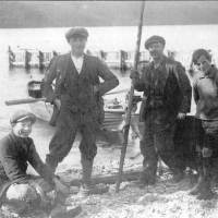 Macleod's the Pier. Taken at Foyers Pier c1920  L-R Bob Macleod, William Macleod (Kil) , Murdo Macleos ( Pier Master for the British Aluminium) & Alexander Macleod (Eck)   Photograph courtesy of Ala Macgruer , names provided by  Kathy Stoddart  Eck daughter.