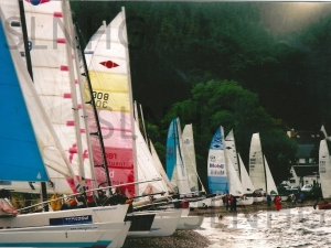 A Loch Ness Yacht race involving  mainly boats from England . The  contestants camped in field nearest Dores beach ,then the next day  sailed up Loch Ness from Dores to Fort Augustus  then raced backed to Dores  it was a one of event  Photograph courtesy of Alistair Grant
