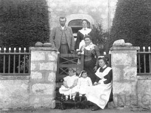 MacGillivray family at garden gate: