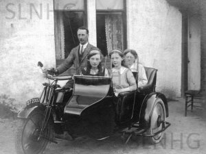 Family on motorbike and sidecar